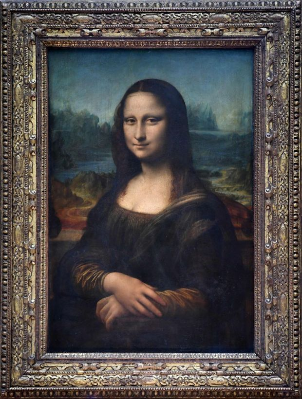 "(FILES) This file photograph taken on October 7, 2019, shows The Mona Lisa (La Gioconda) after it was returned to its place at the Louvre Museum in Paris. - The Louvre in Paris is putting the finishing touches to an ambitious Leonardo da Vinci retrospective opening on October 24, 2019, which groups more than 160 of the artist's works and has already attracted close to 200,000 advance visitor bookings. Timed to coincide with the 500th anniversary of the famed artist's death, the show, simply called ""Leonardo da Vinci"", took a decade to put together and includes works on loan from Queen Elizabeth and Bill Gates. (Photo by ERIC FEFERBERG / AFP) / RESTRICTED TO EDITORIAL USE - MANDATORY MENTION OF THE ARTIST UPON PUBLICATION - TO ILLUSTRATE THE EVENT AS SPECIFIED IN THE CAPTION (Photo by ERIC FEFERBERG/AFP via Getty Images)"