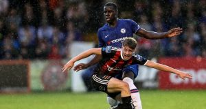 Bohemians' Evan Ferguson is challenged by  Kurt Zouma of Chelsea during a friendly at Dalymount Park back in July. Photograph:  Laszlo Geczo/Inpho
