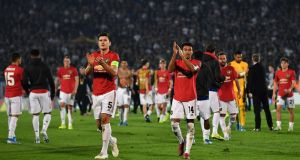 Manchester United players applaud their fans after the 1-0 victory away to Partizan Belgrade in the Europa League. Photo: Andrej Isakovic/Getty Images