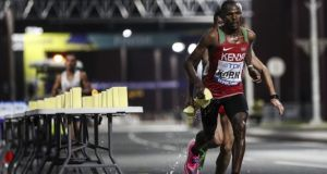 Laban Kipngetich Korir of Kenia splashes water during the marathon in Doha at the World Athletics Championships which was marred by serious heat. Photo: Maja Hitij/Getty Images