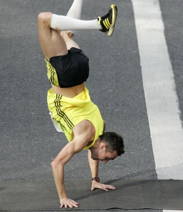 Thomas Bedford, from London, cartwheels over the line at the 2009 marathon. Photograph: Dara Mac Dónaill