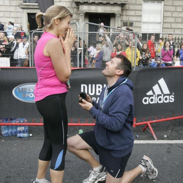 Will Fry proposing to his girlfriend, Rachel Stamford, after they both finished the 2009 marathon. Photograph: Dara Mac Dónaill