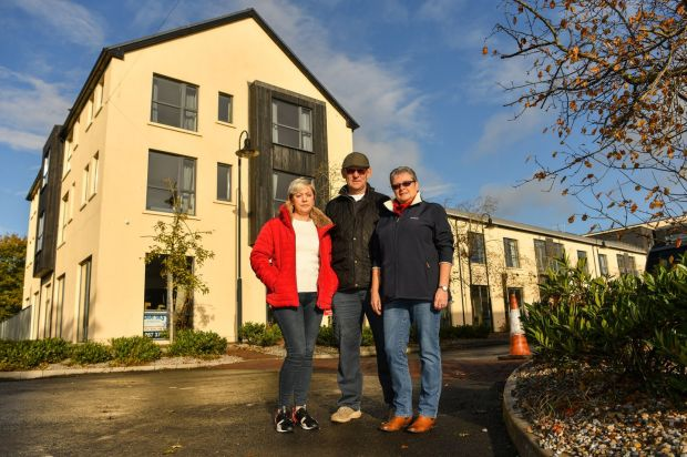 Borrisokane residents Mags Donnelly, Robert Armitage and Margaret Bevan-Hanger at the apartment complex earmarked for asylum seekers. Photograph: Diarmuid Greene