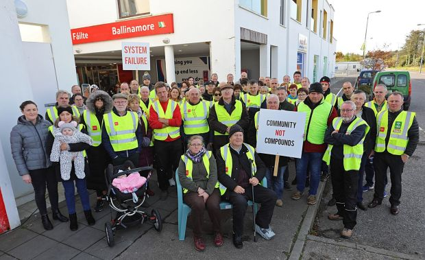 Ballinamore residents protest outside the apartment complex earmarked as a direct-provision centre for 130 refugees. Photograph: Lorraine Teevan