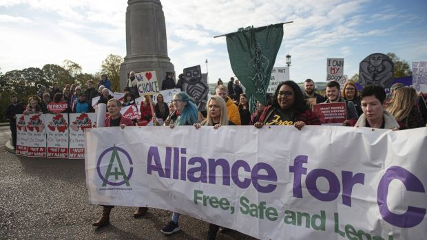 Members of Alliance for Choice make their way past anti-abortion supporters at Stormont. Photograph: Charles McQuillan/Getty