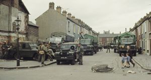 British Army troops with  army Land Rovers and trucks on a  side street  in the predominantly Catholic Falls Road area of Belfast in  May 1971. Photograph: Rolls Press/Popperfoto via Getty Images