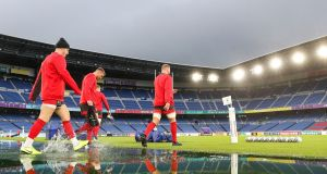 Wales's Gareth Davies, Dan Biggar and Ross Moriarty arrive on a waterlogged pitch for a training session at The International Stadium  Yokohama on Friday. Photograph: David Davies/PA Wire