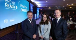 IoD NI chairman Gordon Milligan with Dr Katy Hayward of Queen's University and KPMG's  Frankie Devlin.