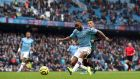 Raheem Sterling opems the scoring for Manchester City. Photograph: Martin Rickett/PA