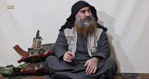 An undated video still of Islamic State leader Abu Bakr al-Baghdadi, who is believed to be dead after a US military raid. Photograph: al-Furqan Media/AFP via Getty Images