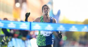 Othmane El Goumri crosses the line to win the Dublin Marathon. Photograph: Ramsey Cardy/Sportsfile