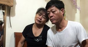 Pham Van Thin (right) and Nguyen Thi Phong (left), father and mother of Pham Thi Tra My, who is believed to be among the 39 people found dead in a container truck in southeastern England, are seen in their home in Vietnam. Photograph:  EPA