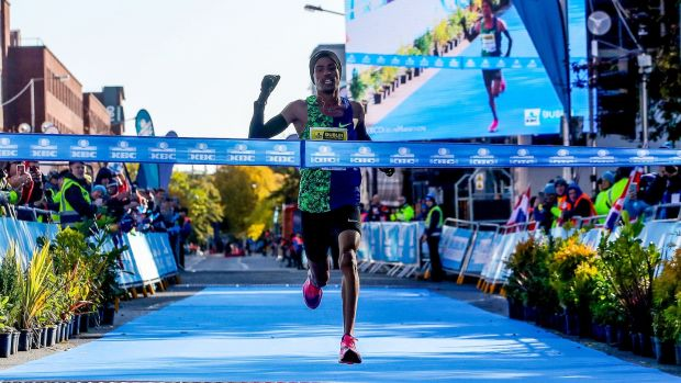 Othmane El Goumri crosses the finish line to take the Dublin Marathon. Photograph: Bryan Keane/Inpho
