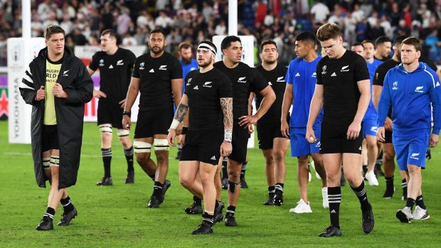 New Zealand players dejected after the final whistle after the defeat to England. Photograph: Andrew Cornaga/Inpho