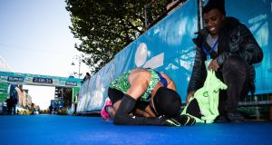 Othmane El Goumri of Morocco, the Mens winner of the Dublin Marathon 2019 on his knees at the finish line after completing the course in a record time of 2 hours 8 minutes and 5 seconds. Photograph: Bryan Keane/Inpho