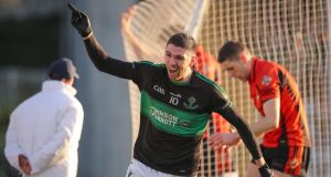Luke Connolly celebrates scoring his and Nemo Rangers'  second goal during the Cork SFC final at  Páirc Uí Rinn. Photograph: Oisín Keniry/Inpho
