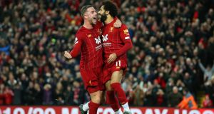 Mohamed Salah  celebrates with Jordan Henderson after scoring his side's second goal in the Premier League game against Tottenham Hotspur at Anfield. Photograph: Jan Kruger/Getty Images