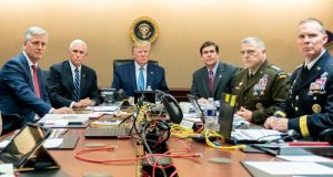US president Donald Trump (centre), US vice president Mike Pence (second from left), US secretary of defense Mark Esper (third from right), along with members of the national security team, watch as US Special Operations forces close in on ISIS leader Abu Bakr al-Baghdadi, from the Situation Room of the White House on Saturday. Photograph:  Shealah Craighead/The White House/Handout/Reuters
