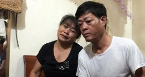 Nguyen Thi Phong and Pham Van Thin, mother and father of Pham Thi Tra My, who is believed to be among the 39 people found dead in a container truck in southeastern England, in their home in Can Loc district, Ha Tinh province, Vietnam. Photograph: EPA/STR