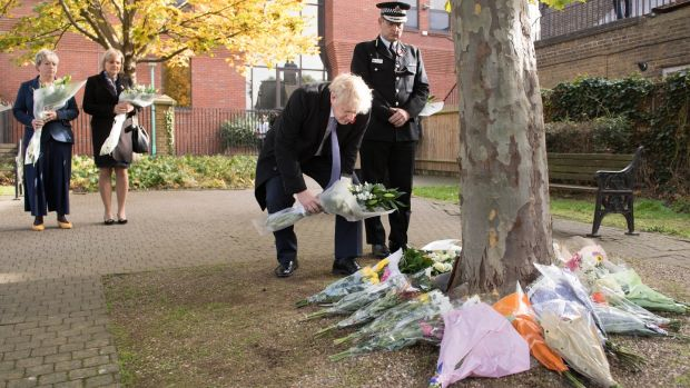 Boris Johnson lays flowers during a visit to Thurrock Council Offices on Monday. Photograph: Getty