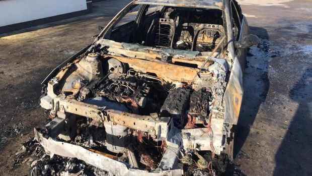 Martin Kenny's car after it was destroyed by fire outside his home. Photograph: Supplied by Brian Farrell