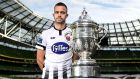 Dundalk's Robbie Benson with the  FAI Cup trophy at the Aviva Stadium in Dublin. 'It's been a hard one to take, missing so much of the season.' Photograph: Harry Murphy/Sportsfile