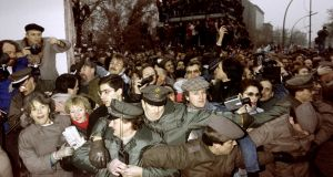 East and West German Police contain the crowd of East Berliners flowing through the recent opening made in the Berlin Wall at Potsdamer Square, on November 12th, 1989. Photograph: Patrick Hertzog/AFP/Getty Images