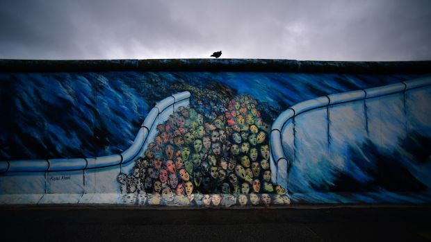 A raven sits on top of remaining pieces of the Berlin Wall at the East Side Galleray, an open-air gallery consisting of a series of murals painted directly on the remnants of the Berlin Wall, October 3rd, 2019. Photograph: Alexander Koerner/Getty Images)