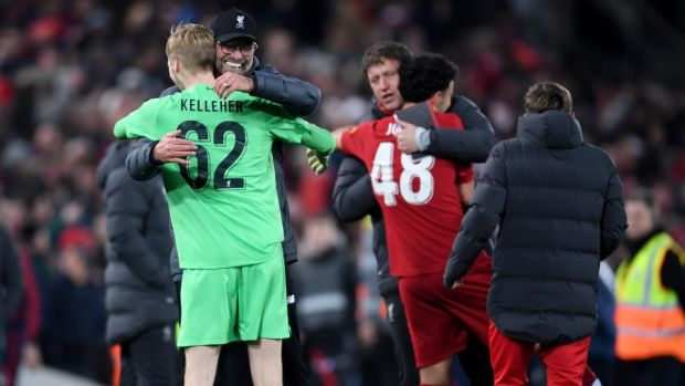 Liverpool manager Jürgen Klopp hugs goalkeeper Caoimhín Kelleher after the penalty shootout. Photograph: Laurence Griffiths/Getty Images