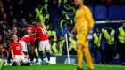 Manchester United's Marcus Rashford celebrates with Scott McTominay and teammates after scoring the winner in the Carabao Cup fourth round clash with Chelsea. Photo: Eddie Keogh/Reuters