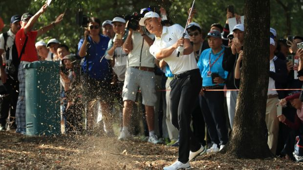 Haotong Li hits his second shot on the seventh. Photo: Andrew Redington/Getty Images
