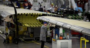 A worker inspects an aeroplane wing in the Bombardier factory in Belfast. Photograph: Clodagh Kilcoyne/Reuters