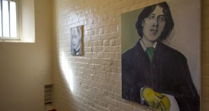 A portrait of Oscar Wilde hangs inside a cell as part of an exhibition at Reading Gaol in 2016. File photograph: Dan Kitwood/Getty Images