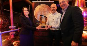 Rosanna Goswell of Tuath Glass presenting the overall award for Irish Whiskey of the Year 2019 for The Irishman 17-Year-Old Single Malt to Bernard Walsh (Walsh Whiskey) with Colm Egan (Irish Whiskey Association)