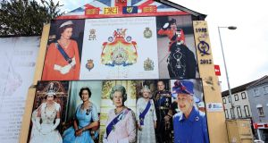 A building decorated with loyalist pictures of Britain's Queen Elizabeth II on the Shankill Road in Belfast. Photograph:  Paul Faith/AFP