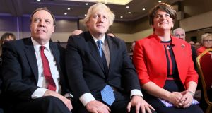 DUP deputy leader Nigel Dodds, British prime minister Boris Johnson and DUP leader Arlene Foster at the DUP conference in November 2018. Photograph: Paul Faith/AFP via Getty Images