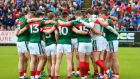 The Mayo team in a huddle in MacHale Park, Castlebar, Co Mayo. Financier Tim O'Leary  disclosed in September that he was interested in securing the naming rights for  MacHale Park. Photograph: James Crombie/Inpho