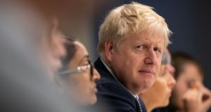 Britain's prime minister Boris Johnson visits Metropolitan Police training college in  London on Thursday. Photograph: Aaron Chown/Reuters