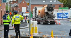 The scene of a fatal collision between a cement mixer truck and a cyclist just outside the rear entrance to St James Hospital and the construction of the National Children's Hospital. Photograph: Alan Betson/The Irish Times