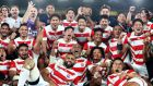 Japan players celebrate their victory over  Scotland at International Stadium Yokohama. The home side's daring, energetic, high-tempo rugby thrilled all spectators. Photograph: Clive Rose/Getty Images