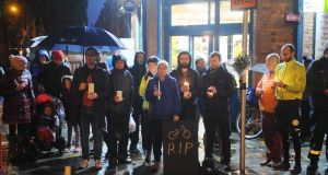 Cyclists and local residents held a vigil at the scene where a cyclist was killed on Friday  morning near  St James's Hospital in Dublin 8. Photograph: Aidan Crawley/The Irish Times.