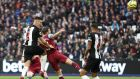 Ciaran Clark heads in a goal for Newcastle United against West Ham United at London Stadium. Photograph: Alex Pantling/Getty Images