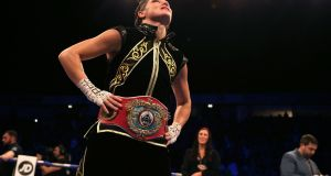Katie Taylor celebrates victory against Christina Lindardatou in their WBO Super-Lightweight World Title bout at Manchester Arena. Photograph: PA