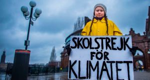 Swedish climate activist Greta Thunberg holds a placard reading 'School strike for the climate' during a protest against climate change outside the Swedish parliament in November 2018. Photograph: Hanna Franzen/AFP/Getty Images