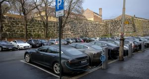 Electric vehicles sit parked at charging stations  in Oslo, Norway. File photograph:  Fredrik Bjerknes/Bloomberg via Getty Images