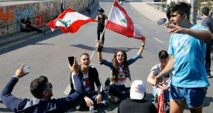 Anti-government protesters  block a main highway in Beirut, Lebanon, on Monday. Photograph: Bilal Hussein/AP