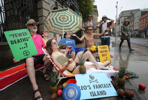 LEO'S FANTASY ISLAND? Extinction Rebellion climate-change activists stage a non-violent protest at the entrance to the Dáil, seeking to mock Taoiseach Leo Varadkar's comments that climate change will bring benefits to Ireland in the form of warmer winters. The activists wore swimsuits and had other props related to sunny climes. Photograph: Nick Bradshaw