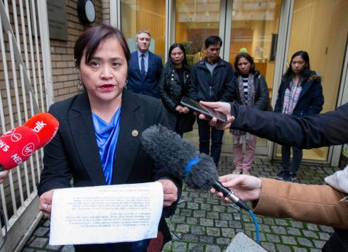JASTINE VALDEZ INQUEST: Vanda Brady, director of communications at the Philippines Consulate in Dublin, reads a statement as Teresita and Danilo Valdez (left), parents of the late Jastine Valdez, look on with family friends at the inquest into her death. Ms Valdez died in May 2018 after being abducted by the late Mark Hennessy, near Enniskerry, Co Wicklow. Photograph: Colin Keegan/Collins Dublin