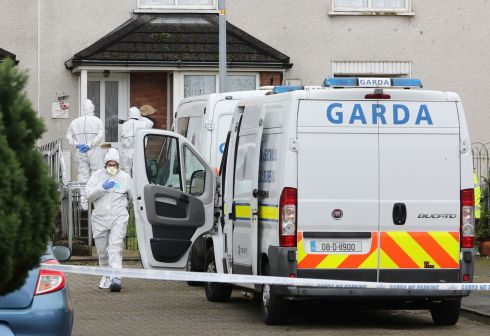 DEATH OF BOY: Forensic Garda officers at a house in Shanabooly Road in Limerick, where the body of a boy aged 11 was discovered on Sunday evening. He is believed to have died after an assault. Photograph: Niall Carson/PA Wire