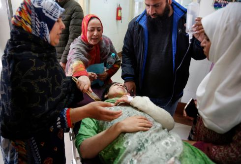 KASHMIR ATTACK: A woman injured by a grenade blast is carried into a local hospital in Srinagar, Kashmir, India. One civilian was killed and about 20 others were injured in the grenade attack in a crowded marketplace, perpetrated by suspected militants. Photograph: Farooq Khan/EPA